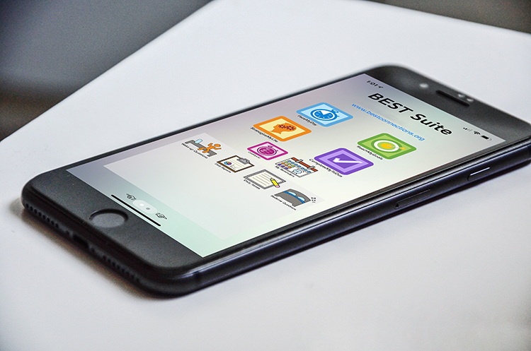 iPhone with BEST Suite Home screen on table