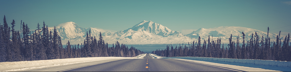 Empty highway with mountains